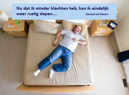 Big man lying sprawled on a king size bed